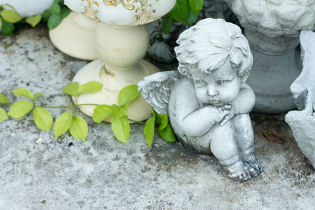 cupid statues adorn in the garden