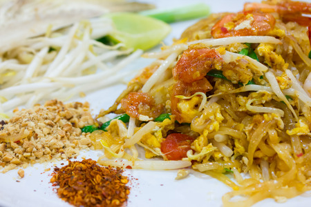 Pad Thai and shrimp with vegetable in white dish, Thai style noodle Stock Photo