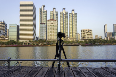 camera on tripod take picture at park with city view,Bangkok Thailand