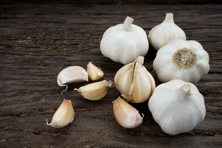 Garlic cloves on wooden background