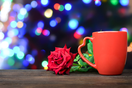 Red cup with red rose flowers for Valentine's day Stock Photo