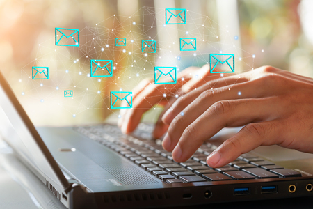 Businessman hand using Laptop pc with email icon, Email concept