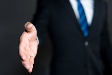 Business man open hand ready to seal a deal, partner shaking hands Stockfoto