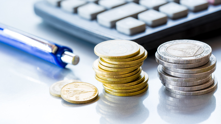 Stack of coins money with account book finance and banking concept for background.concept in grow and walk step by step for success in business