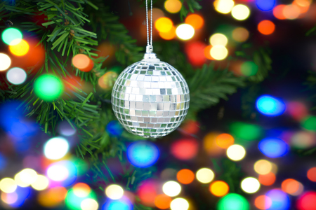 Colorful christmas Decoration. Winter holidays and traditional ornaments on a Christmas tree. Lighting chains
