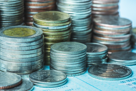 Money, Financial, Business Growth concept, There is money coins to stack of coins. Close up of coins to stack of coins,Saving money for retirement planning.