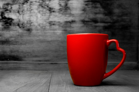 Red cup on a black background