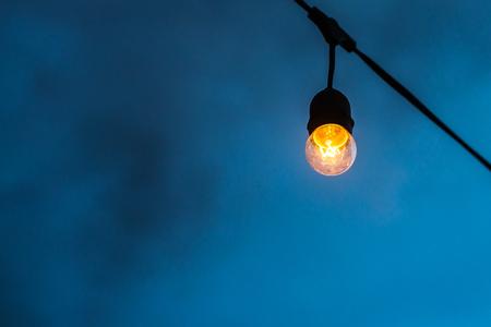 Decorative beautiful vintage lamp bulbs at twilight time. Stock Photo
