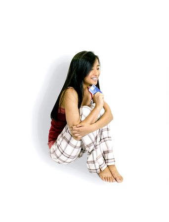 Girl Sitting With A Credit Card photo