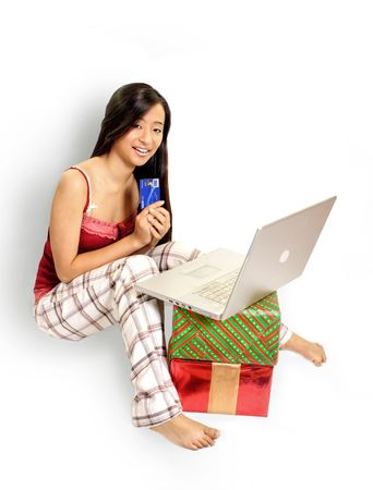 deliberate: Girl On Laptop With Credit Card Stock Photo