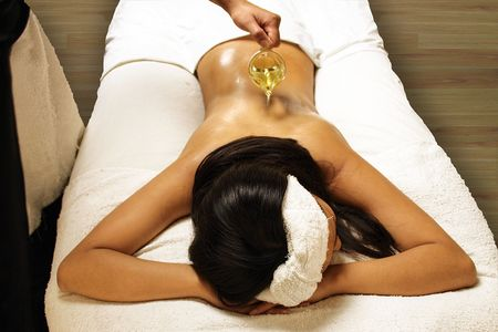 throbbing: Oil Massage at Spa Stock Photo