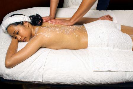 Sea Salt Scrub Massage Treatment in a spa setting.