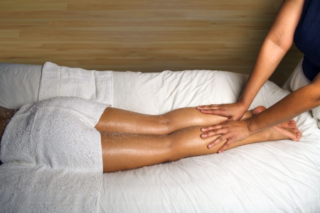 african american spa: SPA LEG AND FOOT MASSAGE DETAIL Stock Photo