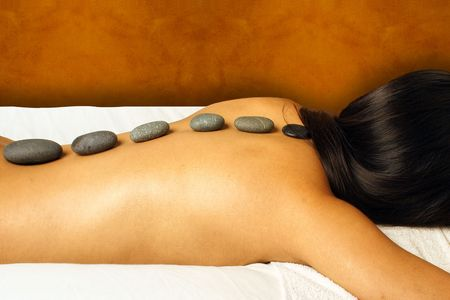 holistic: HOT STONE MASSAGE Stock Photo