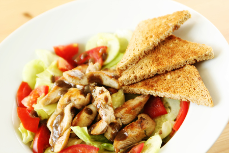 wheat toast: Grilled chicken with vegetable salad and whole wheat toast Stock Photo