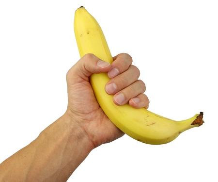platano maduro: mano humana que sostiene un pl�tano maduro