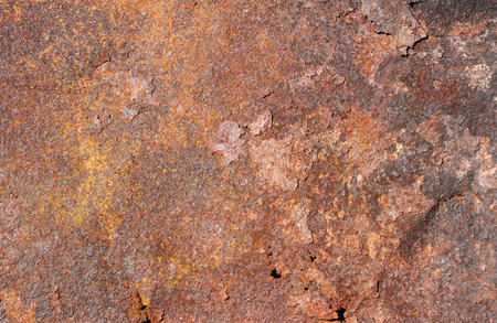 rusty metal exfoliating sheet with holes and cracks, texture Stock Photo