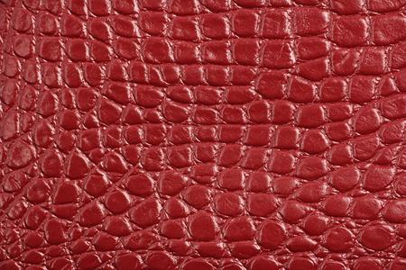 trama di vera pelle naturale rosso marrone rossiccio, come la pelle di coccodrillo, macro primo piano