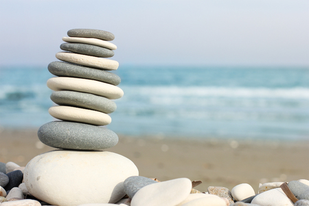 pyramid of pebbles on the beach, close-up and free space for text, southern coast of Cyprus