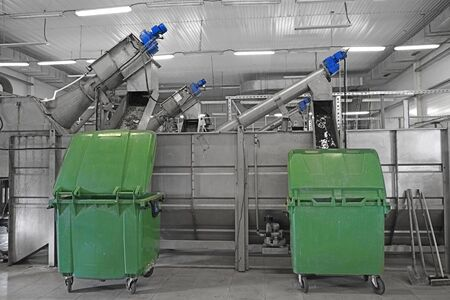 water or wastewater treatment facilities inside or indoors, coarse or large particle filter, green containers for waste or garbage