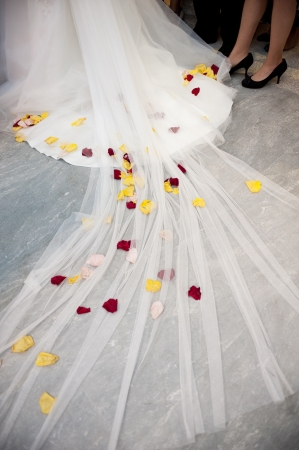 Red and Yellow Flowers in a White Wedding Dress photo