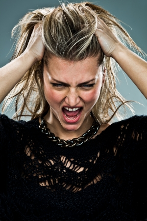 Young Woman Shouting Over a Grey Background Stock Photo - 18443519