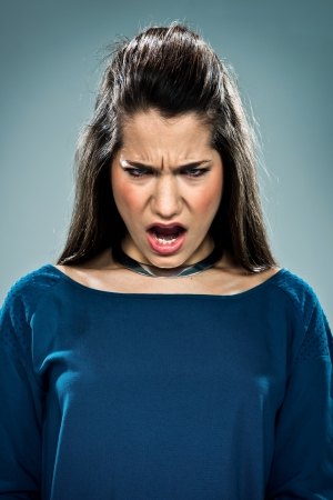 Cute Teenager Shouting Over a Grey Background Stock Photo - 18443557