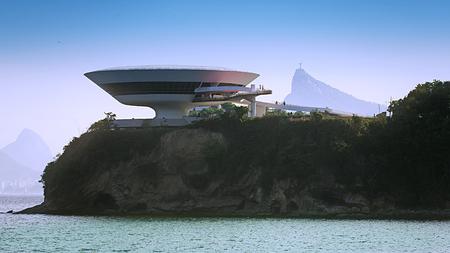 oscar niemeyer: Contemporary Art Museum in Niteroi with Christ Statue, Rio de Janeiro, Brazil