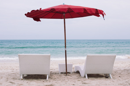 blue romance: Sunbeds on beach with umbrella on Koh Samui, Thailand