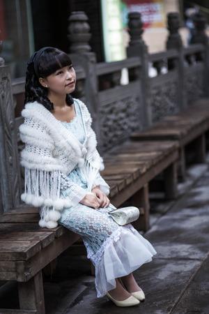 balustrades: Chongqing Hongyadong ancient streets of Chinese girl Stock Photo
