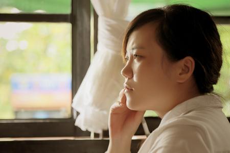 ponder: Chinese girl thinking