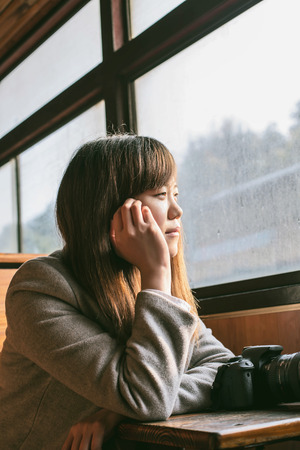 deep thought: girl in train having deep thought