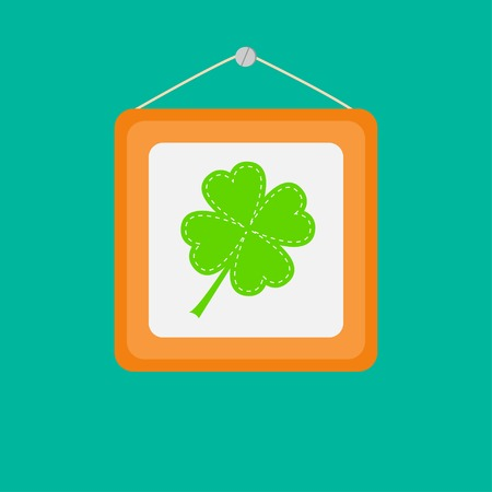 Four leaf clover in a picture frame on the wall Vector