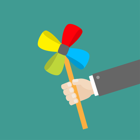 Businessman hand holding paper windmill pinwheel toy on stick. Green background. Isolated. Flat design Vector illustration