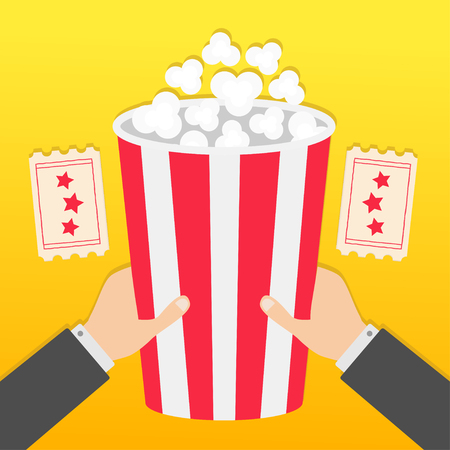 Two human businessman hands holding big popcorn box. Two Tickets with stars. Movie Cinema icon in flat design style. Pop corn. Fast food. Yellow gradient background. Vector illustration Illustration