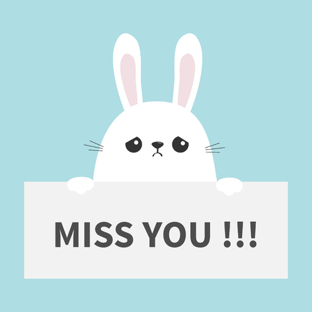 White sad bunny rabbit hanging on paper board Miss you.
