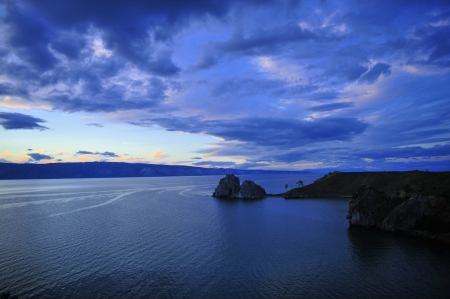 Shaman Rock in sunset, in Olkhon Island, Russia photo