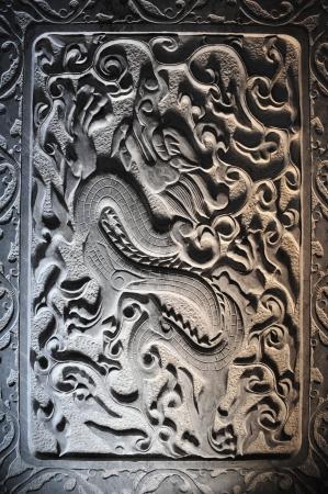 Dragon stone sculpture in wall, Chi photo