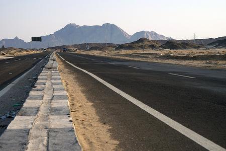 lonely Street in the Desert of Egypt .