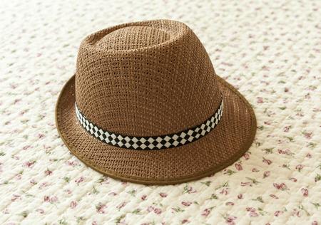 Brown Hat on vintage background photo