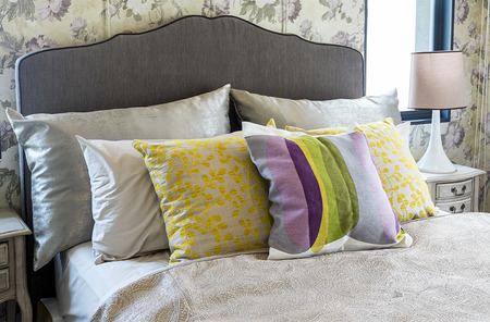 Colorful pillow on bed photo