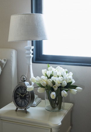 lamp: white lamp and alarm clock on bedside table