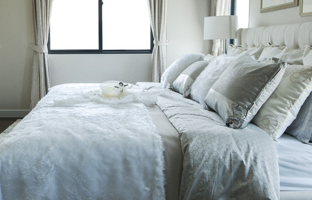 white and grey pillow on bed photo