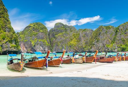green boat: boats at Maya bay Phi Phi Leh island, Thailand