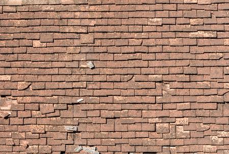 asphalt shingles: background of crackled shingle roof