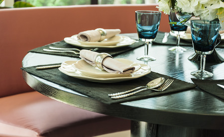 Ceramic tableware on the table photo