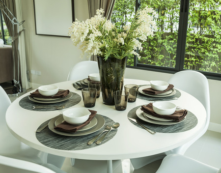 dining table and artificial flower in modern dining room photo