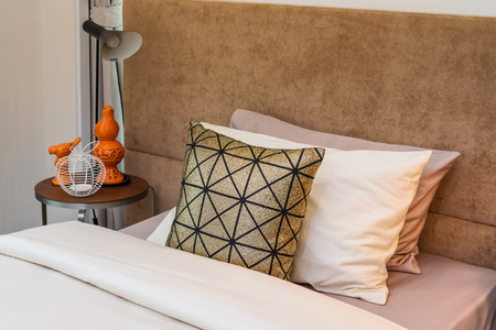 bedside lamp: single bed with bedside tables and reading lamp