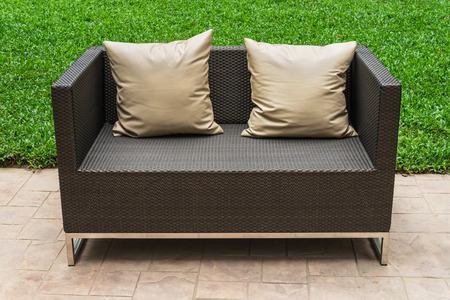 seating area: Outdoor patio seating area with Rattan sofa