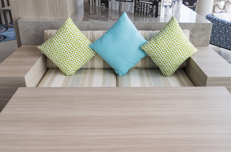 louver: Bright Living room with modern wooden chairs and pillows Stock Photo